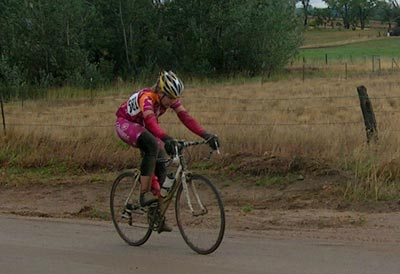 Boulder Roubaix - Woman climbs up a hill on the course